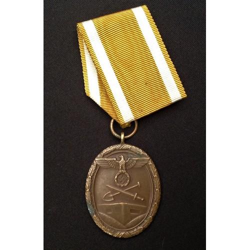 54 - WW2 Third Reich Deutsches Schutzwall-Ehrenzeichen - West Wall Medal. Compete with ribbon. Early Tomb...