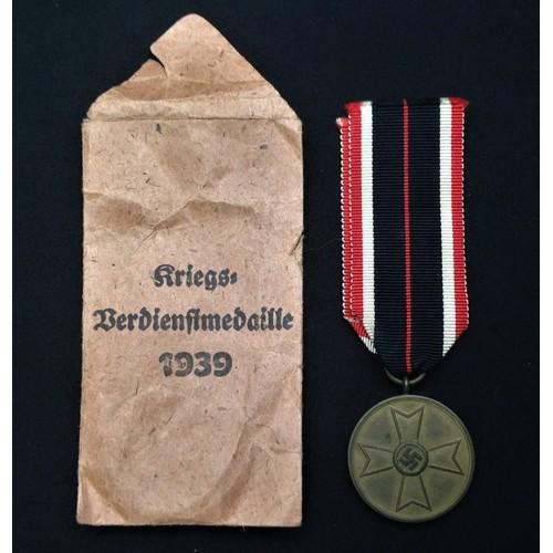 55 - WW2 Third Reich Kriegsverdienstmedaille - War Merit Medal. Complete in original packet of issue with...