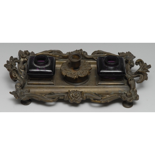 3017 - A 19th century bronze inkstand, cast with flowerheads and scrolling leaves, the central wafer box en...