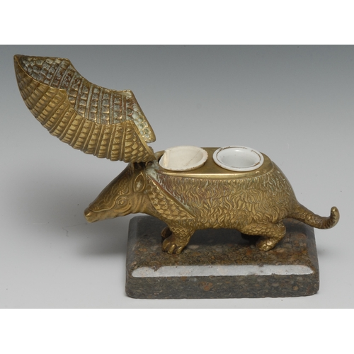 3018 - A 19th century bronze novelty animalier encrier, cast as an armadillo, hinged cover enclosing a pair...