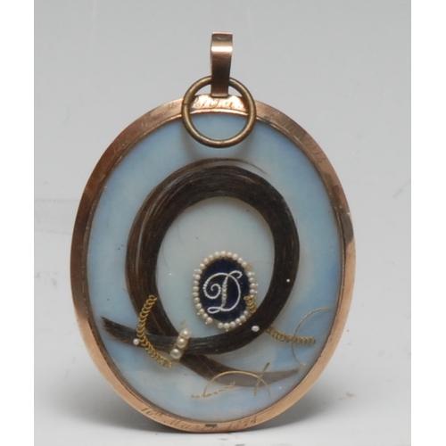 3038 - A 19th century gilt metal locket frame, inscribed Hon Richard Charteris, 16th March 1874, enclosing ...