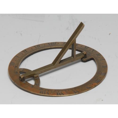 3015 - A 19th century brass travelling sun dial, the gnomon folding for the pocket, 7cm diam