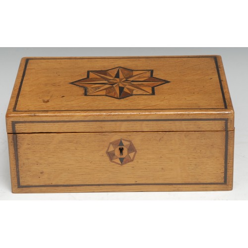3049 - A 19th century oak and parquetry rectangular box, hinged cover inlaid in specimen timbers with a sta...