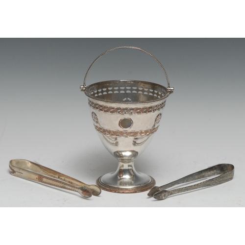 47 - A George III Old Sheffield Plate swing-handled urnular pedestal sugar basket, pierced in the Neo-Cla...