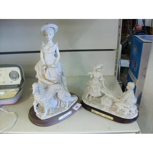 19 - 2 White Figurine Ornaments (sd)...