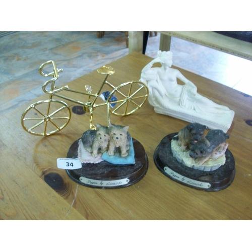 34 - Four Decorative Ornaments...