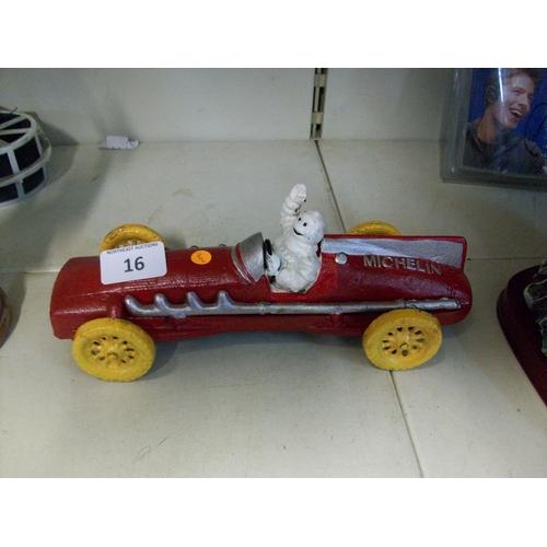 16 - Cast Iron Michelin Man in Car...