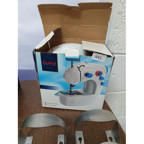 441 - Mini Sewing Machine...