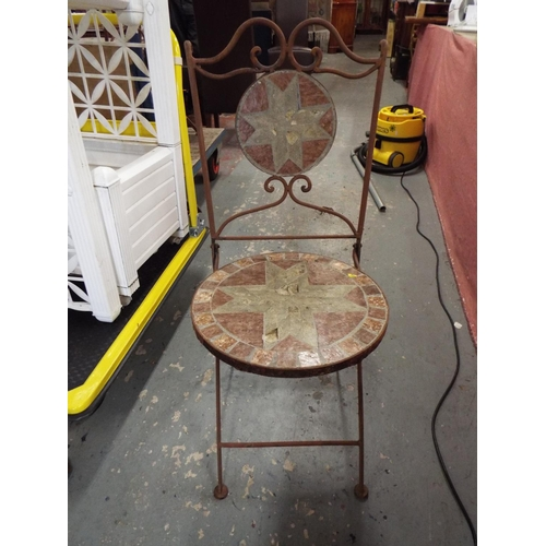 22 - Four Wrought Iron Garden Chairs with Tiled Seats and Backs...