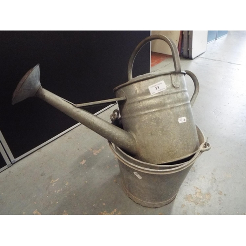 11 - Galvanised bucket/planter with drainage holes and galvanised watering can...