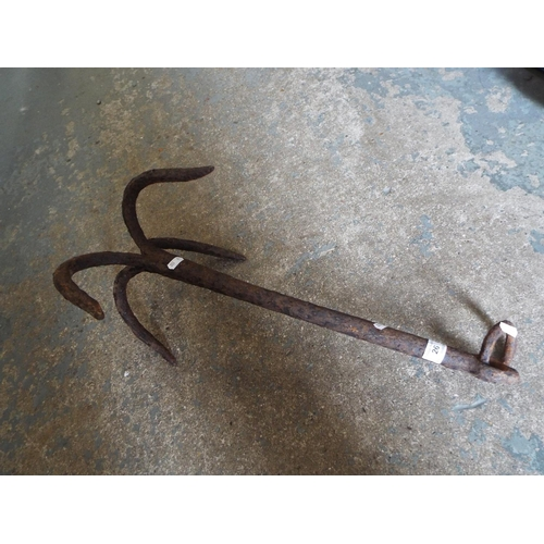 26 - Old iron grappling hook or anchor...