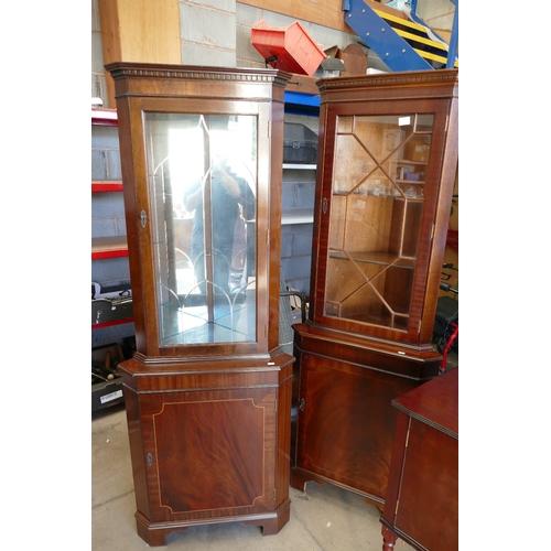 17 - Two mahogany glazed corner units(2)...