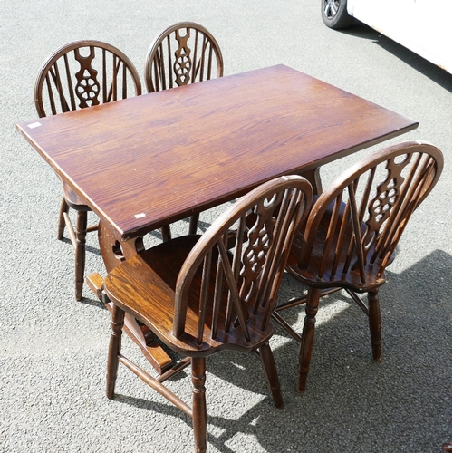 32 - Oak Kitchen table and four matching wheel back chairs(5)...