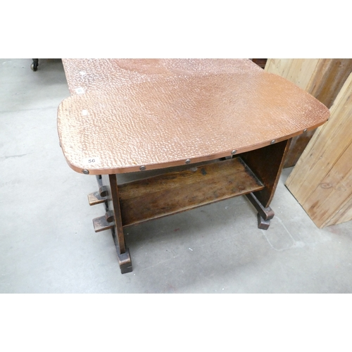 56 - 20th Century oak arts and craft hand beaten brass topped pub/coffee table...