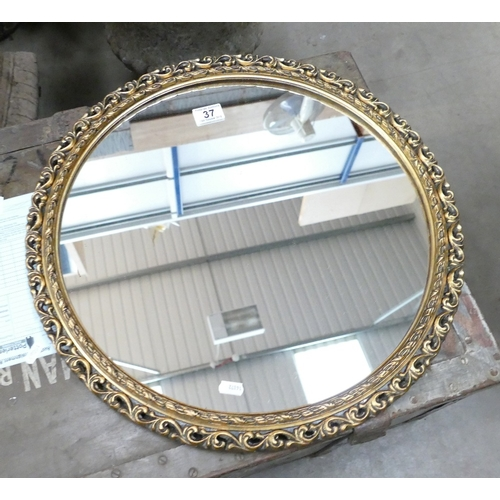 37 - Gilt framed circular wall hanging mirror...