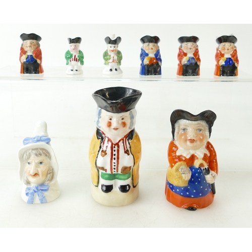 281 - Eight Royal Worcester miniature Toby jugs dated 1937, together with a candle snuffer Mrs Caudle date...