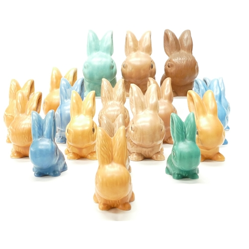 288 - A good collection of Wadeheath models of seated rabbits in various sizes and colours including blue,...