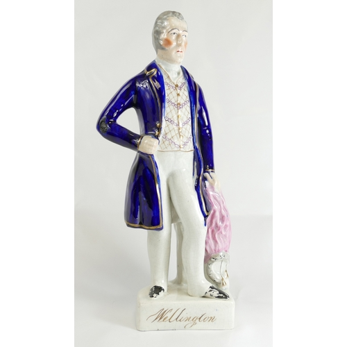 318 - Wellington Staffordshire figure. 34cm....