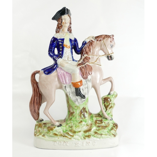 326 - Tom King on horse Staffordshire figure. 31cm....