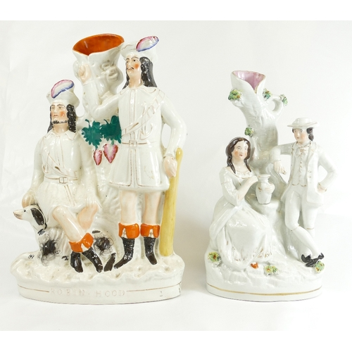 346 - Two large Staffordshire spill vase groups, ROBIN HOOD 37cm, together with a PAIR OF LOVERS, 32cm (2)...