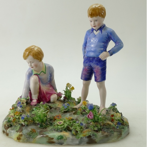 468 - A Crown Staffordshire large figure group of a girl picking flowers and boy standing, by J T Bailey...