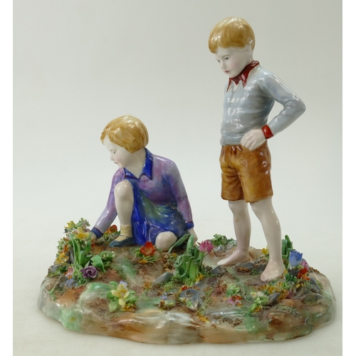 469 - A Crown Staffordshire large figurine group of a girl picking flowers and a boy standing, by J T Bail...