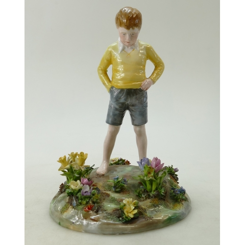 470 - A  Crown Staffordshire figurine of a boy standing, by J T Bailey...