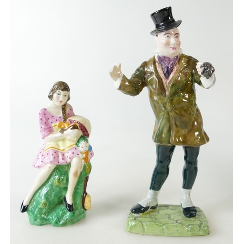 475 - Two Crown Staffordshire figures one of a girl with toys and McCawber (2)...