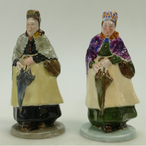 479 - Two Crown Staffordshire figurines of an Old Lady with an umbrella in two different colourways (2)...