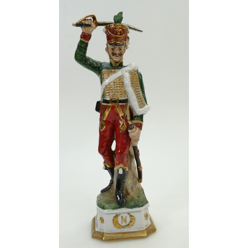 219 - Large French porcelain figure of Napoleonic soldier, height 31cm....