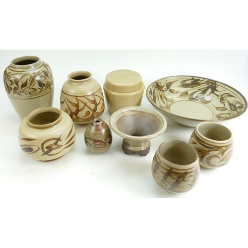 256 - A collection of  Bullers ware vases, storage jars and bowls. Mainly signed Angus Hoy (9)...