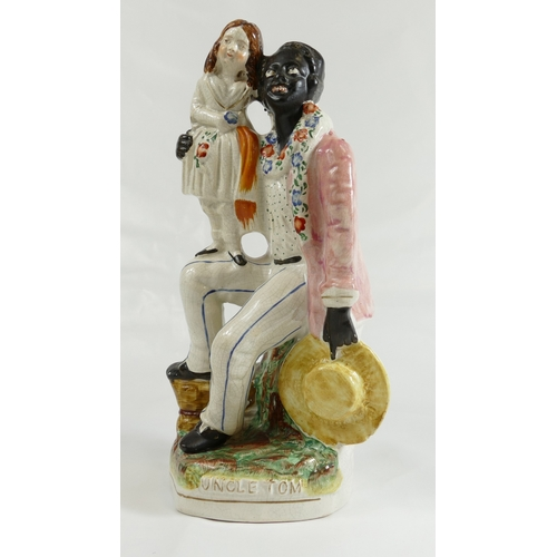 301 - Uncle Tom Staffordshire figure, earlier figure, man with girl on knee 27cm....