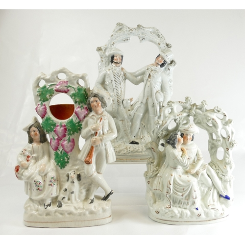 312 - Three large Staffordshire figures - 2 arbour groups and watch holder, 26 - 33.5cm (3)...