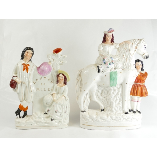 333 - Large Staffordshire flatback figure of a girl on horse with man attending 34cm, together with a 'Lon...