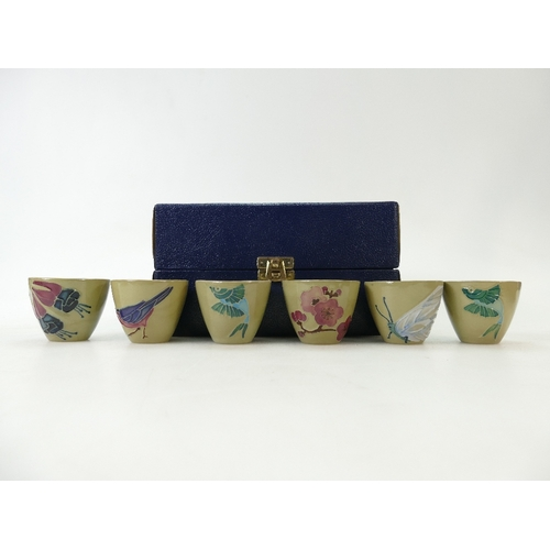 506 - MOORCROFT SAKI CUPS, set of six, cased.  Each measuring 4.5cm, and with a different subject depicted...