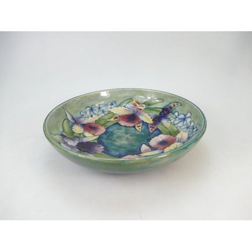 514 - William Moorcroft large footed fruit dish decorated with the slipper orchid design, diameter 32cm...