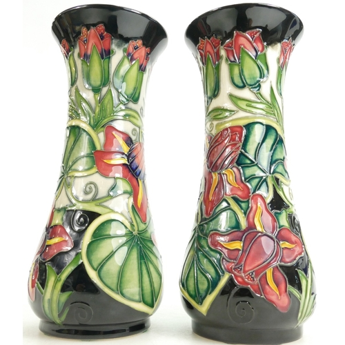 521 - Moorcroft Lily Leaf and Flower decorated pair of vases, height 21cm...