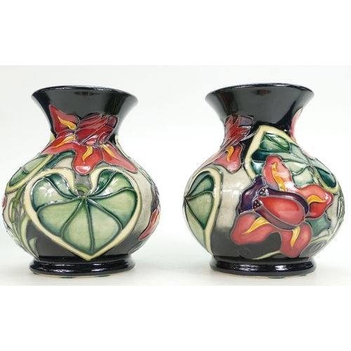 524 - Moorcroft Anna Lily design pair of vases, height 9cm, both boxed (2)...