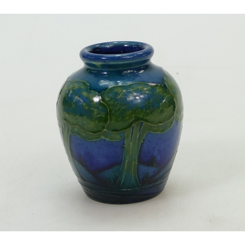 533 - William Moorcroft small vase in the Moonlit blue design, height 9cm (slight glaze chip to top rim)...