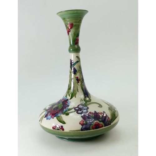 544 - William Moorcroft vase in the Persian design, height 26cm (3cm firing crack to top rim)...
