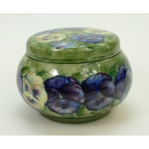 550 - William Moorcroft tobacco jar & cover decorated in the Pansy design, diameter 15cm (star crack to ba...