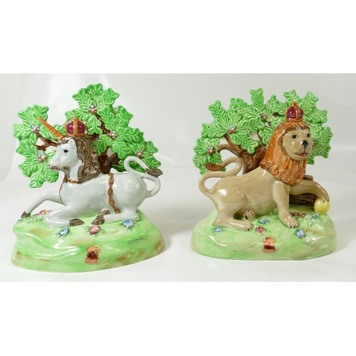 575 - A pair of Beswick Staffordshire models of  old lion 2093 and unicorn 2094 (2)...