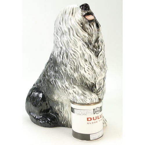 592 - Beswick advertising model of seated Old English Sheep Dog with paw on Dulux paint tin 1990, height 3...