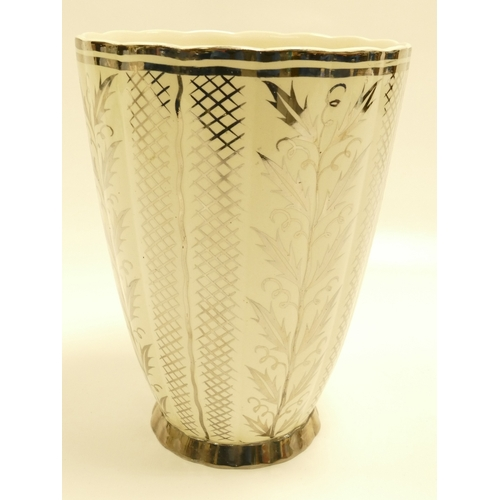 642 - Wedgwood ribbed vase designed by Keith Murray and decorated with silver lustred decoration of flower...