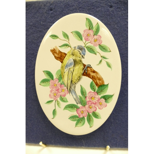 648 - Oval pottery plaque handpainted with Blue Tit on branch with flowers and another similar painted wit...