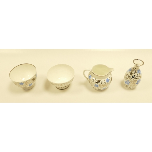650 - A collection of Wedgwood small items each decorated with silver lustre decorations of swirling blue ...