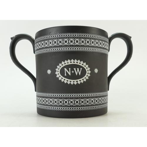 668 - Wedgwood black Jasperware two handled loving cup presented to Norman Wilson on his retirement 1927-1...