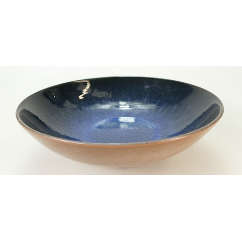 679 - Wedgwood footed studio dish decorated with speckled blue and white colours inside and speckled brown...