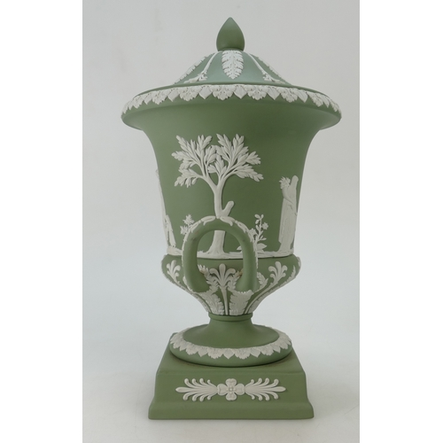 690 - Wedgwood green Jasperware two handled vase & cover decorated all around with classical scenes, dated...