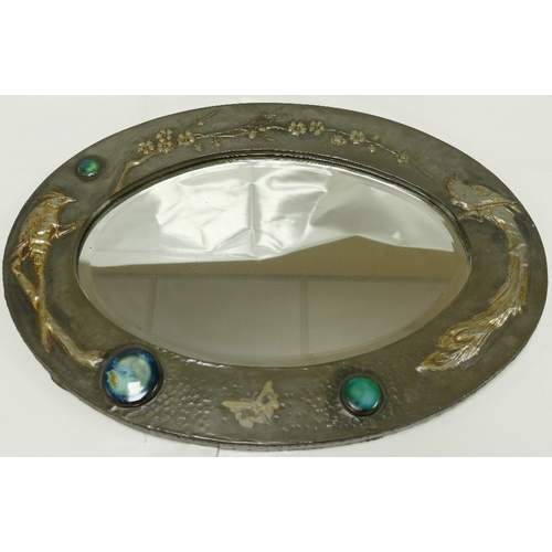 858 - Arts and Crafts embossed Pewter framed oval mirror with Ruskin style high fired ceramic medallions, ...